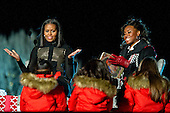 """First lady Michelle Obama and US Olympic medalist Simone Manuel read """"Twas the Night Before Christmas"""" at the National Christmas Tree Lighting on the Ellipse in Washington, DC on Thursday, December 1, 2016.<br /> Credit: Ron Sachs / Pool via CNP"""