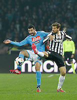 Raul Albiol  and  Ferdinando Llorente fight for the ball with during the Italian Serie A soccer match between SSC Napoli and Juventus FC   at San Paolo stadium in Naples, March 30 , 2014
