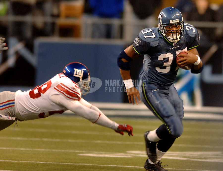Nov. 27, 2005; Seattle, Wash, USA;  Seattle Seahawks running back #37 Shaun Alexander avoids a diving New York Giants defender in overtime at Qwest Field. Mandatory Credit: Photo By Mark J. Rebilas