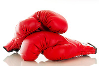 Close up of a pair of red boxing gloves