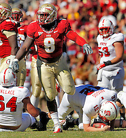 TALLAHASSEE, FL 10/29/11-FSU-NCST102911 CH-Florida State's Timmy Jernigan comes up after sacking N.C. State's Tyler Brosius during second half action Saturday at Doak Campbell Stadium in Tallahassee. The Seminoles shut out the Wolfpack 34-0..COLIN HACKLEY PHOTO