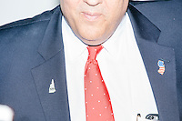 """New Jersey governor and Republican presidential candidate Chris Christie is seen wearing lapel pins in the shape of the states of New Jersey and New Hampshire as he greets people after speaking at a """"Life of the Party"""" event at the New Hampshire Institute of Politics at Saint Anselm College in Goffstown, New Hampshire, on Tues., Feb. 2, 2016. The event is put on by Stay Work Play NH, a group for young professionals in the state. The day before, Christie tenth in the Iowa Caucus."""