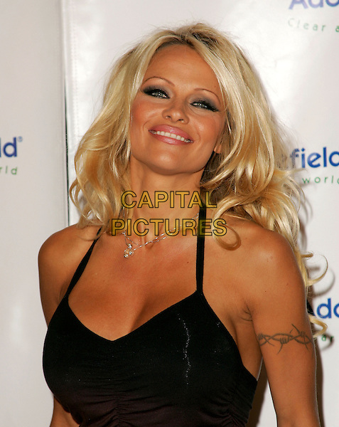 PAMELA ANDERSON.The 4th Annual Benefit Gala for Adopt-A-Minefield held at The Century Plaza Hotel in Century City, California.October 15th, 2004.headshot, portrait, halterneck, tattoo.www.capitalpictures.com.sales@capitalpictures.com.©Debbie Van Story/Capital Pictures