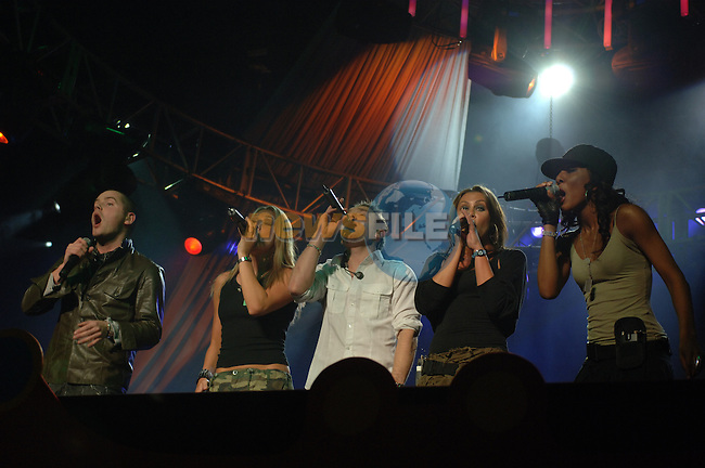 Liberty X on stage at the 2006 Childline Concert in the Point Depot in Dublin...Photo NEWSFILE/Colin Bell.(Photo credit should read Colin Bell/NEWSFILE)....This Picture has been sent you under the condtions enclosed by:.Newsfile Ltd..The Studio,.Millmount Abbey,.Drogheda,.Co Meath..Ireland..Tel: +353(0)41-9871240.Fax: +353(0)41-9871260.GSM: +353(0)86-2500958.email: pictures@newsfile.ie.www.newsfile.ie.FTP: 193.120.102.198..