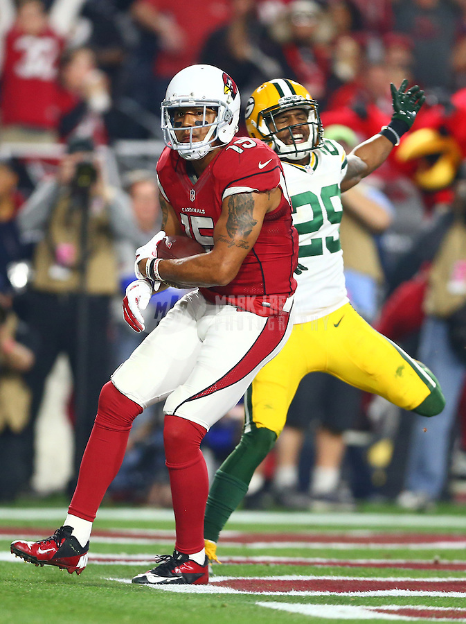 Jan 16, 2016; Glendale, AZ, USA; Arizona Cardinals wide receiver Michael Floyd (15) catches a touchdown pass as Green Bay Packers cornerback Casey Hayward reacts during an NFC Divisional round playoff game at University of Phoenix Stadium. Mandatory Credit: Mark J. Rebilas-USA TODAY Sports