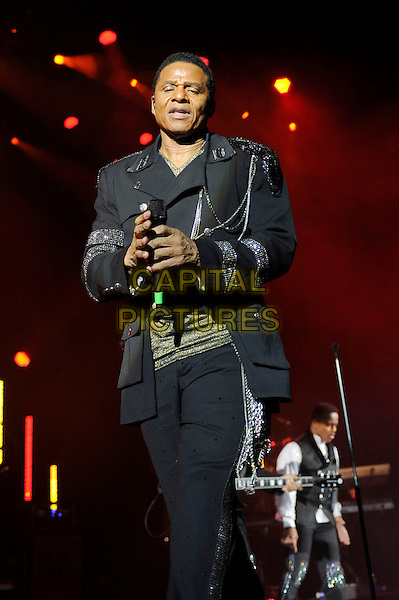 Jackie Jackson.performing in concert as part of The Jacksons, Hammersmith Apollo, London, England. .3rd March 2013.on stage live gig performance music half length black suit.CAP/MAR.© Martin Harris/Capital Pictures.