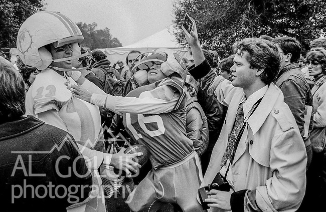 Mock quarterback battle at the Super Bowl XIX tailgate on the Stanford University campus. The San Francisco 49ers defeated the Miami Dolphins 38-16 on Sunday, January 20, 1985.