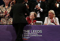PICTURE BY VAUGHN RIDLEY/SWPIX.COM - Leeds International Piano Competition 2012 - Leeds Town Hall, Leeds, England - 15/09/12 - Dame Fanny Waterman congratulates Jiayan Sun of China with the 3rd place Award.