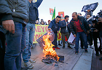 Pictured: Kurdish protesters burn a placard with an Erdogan picture next to a Nazi symbol in Syntagma Square in Athens Greece. <br /> Re: Kurdish people with protest against the Turkey president  Recep Tayyip Erdogan's visit to Greece. Thursday 07 December 2017