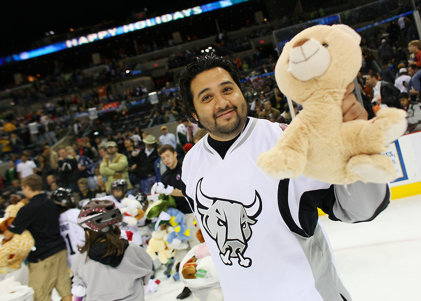 Rampage emcee J.C. Carpenter picks up teddy bears during the third period of an AHL hockey game, Friday, Dec. 17, 2010, at the AT&T Center in San Antonio. Texas won 3-0. (Darren Abate/pressphotointl.com)
