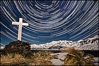 BNPS.co.uk (01202 558833).Pic: SamanthaCrimmin/BNPS..***Please Use Full Byline***..Star trails above Hope Point in South Georgia...A British Doctors braved freezing conditions to capture unique pictures of the night sky from the tiny British island of South Georgia in the remote South Atlantic...Amateur photographer Samantha Crimmin's stunning photos of the sky at night over South Georgia have left locals so star-struck they have been turned into stamps...Dr Samantha Crimmin was working as an emergency medic for the British Antartic Survey team when she took the celestial images in her spare time...Dr Crimmin used long exposures and plenty of patience to create the incredible shots that show star trails in a perfect circular motion...Her gallery of photos depict the night sky above different locations on the tiny outpost in the south Atlantic...They include one above the Harker Glacier - named after British geologist Alfred Harker - and over the wrecks of two Norwegian whaling ships at Grytviken.