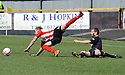 Clyde's Gavin Brown is caught late by Partick's Hugh Murray.