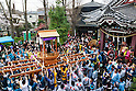 Participants carry a large steel phallus during the Kanamara Festival in Kawasaki on April 3, 2016, Kanagawa, Japan. The Kanamara Matsuri or Festival of the Steel Phallus is held on the first Sunday of April at the Kanayama shrine. The shrine celebrates a legend of a steel penis and was frequented by prostitutes who wished to pray for protection from sexually transmitted diseases. Visitors now wish for easy delivery, marriage and matrimonial harmony. Because of the large steel phallus the unusual festival has become a tourist attraction attracting many overseas visitors and is used to raise money for HIV charities. Phallus shaped candy, carved vegetables, decorations, and a big parade are all part of the festival. (Photo by Rodrigo Reyes Marin/AFLO)