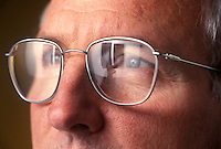 Doctor with x-ray reflected in glasses.