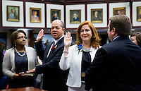 TALLAHASSEE, FLA. 3/4/14-As their spouses hold bibles Reps. Mike Hill, R-Pensacola Beach, second from left, and Amanda Murphy, D-New Port Richey, second from right, are ceremonially sworn in during the opening day of the legislative session, March 4, 2014 at the Capitol in Tallahassee.<br /> <br /> COLIN HACKLEY PHOTO