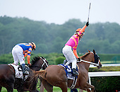 Jose Valdivia Jr. raises his whip in victory after the Belmont Stakes.