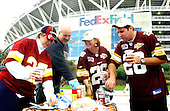 """Landover, MD - October 13, 2002 -- Redskins fans are undeterred by the """"Beltawy Sniper"""" as they enjoy a tail gate party in the parking lot of FedEx Field prior to the NFL game between the Washington Redskins and New Orleans Saints.  FedEx Field, the largest stadium in the NFL, is located off I-95 / 495 one exit below Bowie, MD where a 13 year-old boy was shot by the Sniper on Monday.  From left to right: Lori McGalta, Ray Augusterfer, Casey Augusterfer, and Bernie Augusterfer.<br /> Credit: Ron Sachs / CNP                          <br /> (RESTRICTION: NO New York or New Jersey Newspapers or newspapers within a 75 mile radius of New York City)"""
