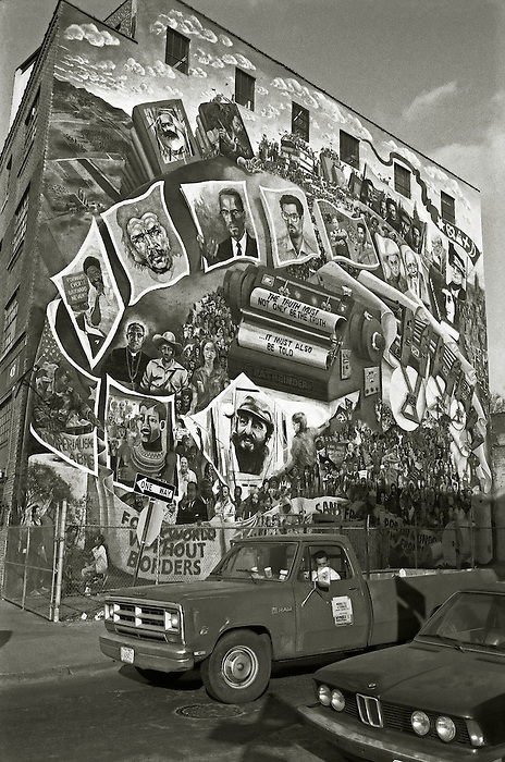 "A mural on the side of a building on Manhattan's West Side Highway, depicting a montage of political and civil rights leaders- Malcolm X,Che Guevara,Fidel Castro etc - emerging as pages from a typewriter bearing the legend ""The truth must not only be the truth...it must also be told."" 1989. Artist unknown [to me...any information welcome]"