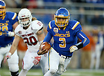 BROOKINGS, SD - NOVEMBER 12:  Taryn Christion #3 from South Dakota State University eyes the end zone  past Alex Coker #20 from the University of South Dakota in the second half at the Dana J. Dykhouse Stadium November 12, 2016 in Brookings, South Dakota. (Photo by Dave Eggen/Inertia)
