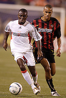 D.C. United's Freddy Adu is chased by the MetroStars' Ricardo Clark. D.C. United defeated the MetroStars 1 to 0 in regular season MLS action on Saturday October 2, 2004 at Giant's Stadium, East Rutherford, NJ..