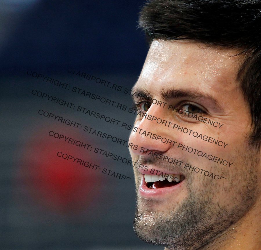 Serbia's player Novak Djokovic, smile, during a team training session in Belgrade, Serbia, Monday, Dec. 1, 2010. France will play against Serbia for the Davis Cup Final starting on December 3-5, in Belgrade. (Srdjan Stevanovic/Starsportphoto.com)