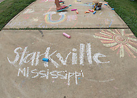 Mississippi State&rsquo;s art department and the university&rsquo;s Ladies Social Circle organization hosted the inaugural Great Chalk Walk Thursday [Aug. 20] in front of the department&rsquo;s Visual Arts Center Gallery at 808 University Drive. Participants of all ages created colorful, large-scale chalk art pieces designed to brighten a major thoroughfare leading to campus. Organizers said the event was well-attended, and they plan to offer similar events in the future. The Great Chalk Walk is among many events in the university&rsquo;s 10th annual Dawg Daze program. A complete Dawg Daze schedule is available at www.dawgdaze.msstate.edu.<br />