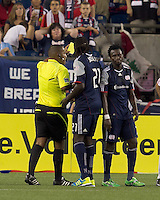 New England Revolution forward Kenny Mansally (7) receives second yellow card and is ejected. In a Major League Soccer (MLS) match, the New England Revolution tied New York Red Bulls, 2-2, at Gillette Stadium on August 20, 2011.