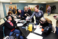 NWA Democrat-Gazette/FLIP PUTTHOFF <br />Poll workers Gina White (left) and Kitrina Napier (cq) (right) help voters on Tuesday Dec. 4 2018 at Bentonville Church of Christ in the Bentonville mayoral election.