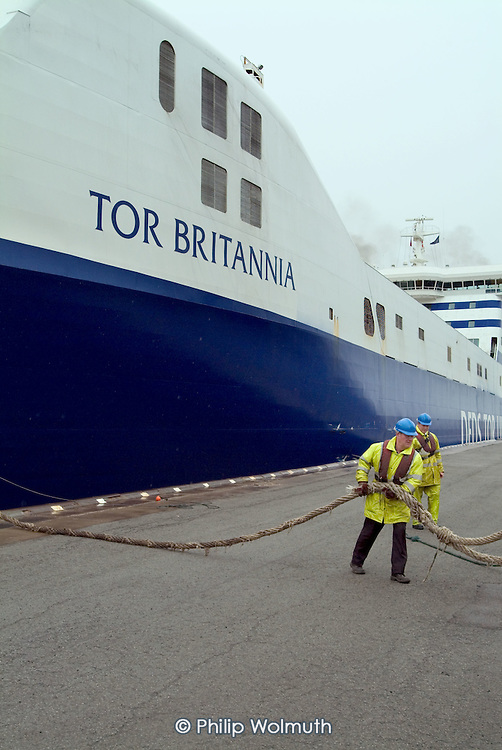 Workers at Immingham Docks, on the Humber estuary, tie up a roll-on roll-off freight ferry as it passes through the harbour lock
