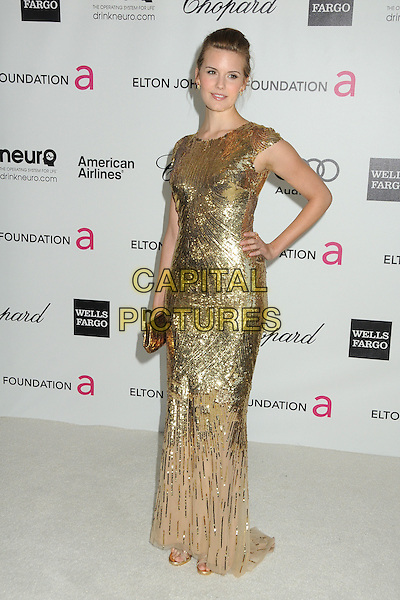 Maggie Grace.20th Annual Elton John Academy Awards Viewing Party held at West Hollywood Park, West Hollywood, California, USA..February 26th, 2012.oscars full length dress hand on hip gold sequins sequined .CAP/ADM/BP.©Byron Purvis/AdMedia/Capital Pictures.