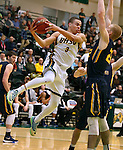 SPEARFISH, SD - JANUARY 8, 2016 -- Patrick Mendes #3 of Black Hills State flies past Regis defender Dexter Sienko #22 during their college basketball game Friday at the Donald E. Young Center in Spearfish, S.D. (Photo by Dick Carlson/Inertia)