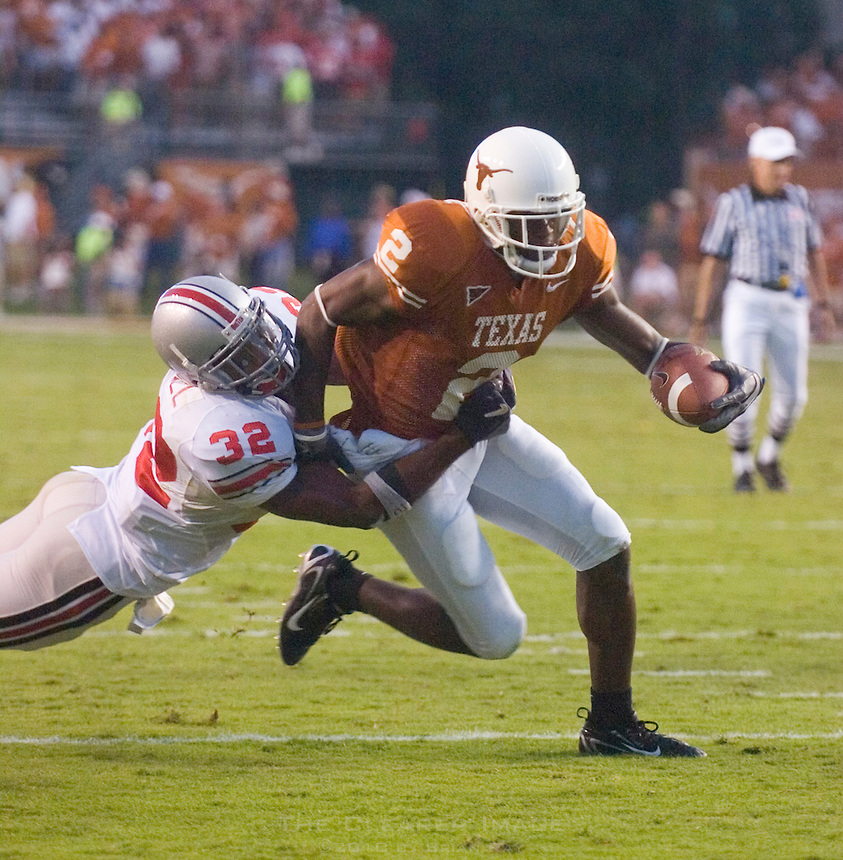 09 September 2006: Texas receiver Billy Pittman is tackled by Ohio State defender Brandon Mitchell during the Texas Longhorns 24-7 loss to the Buckeyes at Darrell K Royal Memorial Stadium in Austin, TX.
