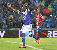 BOGOTA -COLOMBIA- 25-08-2013. Erick Moreno  de Millonarios  celebra su gol  contra el Deportivo Pasto    ,  partido correspondiente a la  sexta fecha de la Liga Postobón segundo semestre disputado en el estadio Nemesio Camacho El Campin     / Millionaires Erick Moreno celebrates his goal against Deportivo Pasto, game in the sixth round of the second half Postobón League match at the Estadio Nemesio Camacho El Campin . Photo: VizzorImage /Felipe Caicedo  / STAFF
