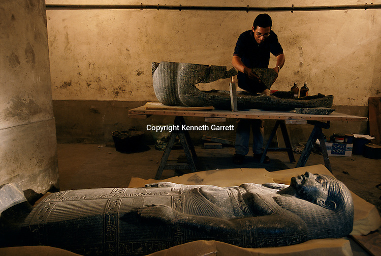 Fragments of the base of the sarcophagus of Senqed is reconstructed, New Kingdom