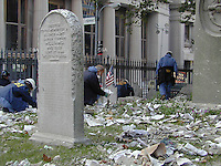 FBI Agents and other Federal Agents comb the cemetery on their hands and knees searching for evidence from the Sept. 11th attack at the World Trade Center in the cemetery at Trinity Church.