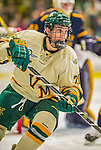 29 December 2013:  University of Vermont Catamount Forward Brendan Bradley, a Freshman from Warminster, PA, in second period action against the Canisius College Golden Griffins at Gutterson Fieldhouse in Burlington, Vermont. The Catamounts defeated the Golden Griffins 6-2 to capture the 2013 Sheraton/TD Bank Catamount Cup NCAA Hockey Tournament for the second straight year. Mandatory Credit: Ed Wolfstein Photo *** RAW (NEF) Image File Available ***