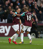 West Ham United's Javier Hernandez celebrates scoring his side's first goal with Joao Mario<br /> <br /> Photographer Rob Newell/CameraSport<br /> <br /> The Premier League - West Ham United v Watford - Saturday 10th February 2018 - London Stadium - London<br /> <br /> World Copyright &copy; 2018 CameraSport. All rights reserved. 43 Linden Ave. Countesthorpe. Leicester. England. LE8 5PG - Tel: +44 (0) 116 277 4147 - admin@camerasport.com - www.camerasport.com
