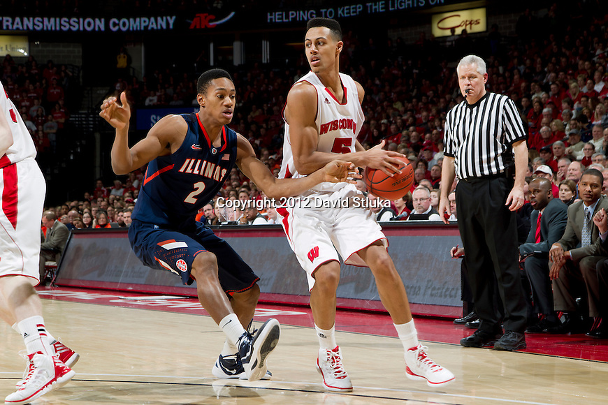 Illinois Fighting Illini guard Joseph Bertrand (2) defends against Wisconsin Badgers forward Ryan Evans (5) during a Big Ten Conference NCAA college basketball game on Sunday, March 4, 2012 in Madison, Wisconsin. The Badgers won 70-56. (Photo by David Stluka)