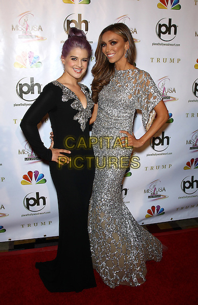 Kelly Osbourne, Giuliana Rancic.2012 Miss USA Pageant red carpet arrivals at Planet Hollywood Resort and Casino, Las Vegas, Nevada, USA..3rd June 2012.full length dress silver sequins sequined black  .CAP/ADM/MJT.© MJT/AdMedia/Capital Pictures.