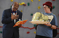 Students react John L. Colbert, superintendent of Fayetteville Public Schools, in the role of Guy, refuses to try the green eggs and ham held by Betty Metcalf, paraprofessional, in the role of Sam Wednesday, March 11, 2020, at Butterfield Trail Elementary School in Fayetteville. The book Green Eggs and Ham by Dr. Suess was performed in front of kindergarten through fourth grade students. Check out nwaonline.com/200312Daily/ and nwadg.com/photos for a photo gallery.<br /> (NWA Democrat-Gazette/David Gottschalk)