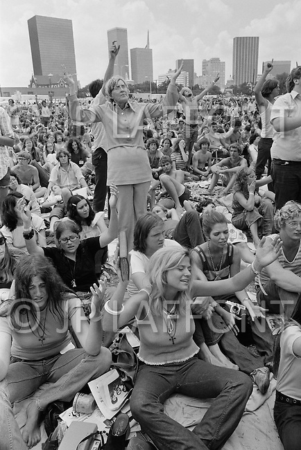 "June 17th 1972, Dallas, Texas, USA. The Explo 1972 was an evangelical conference and festival that took place in Dallas, Texas, from June 12 to June 17. The event was sponsored by the Campus Crusade for Christ and organized by Paul Eshleman. A crowd of 80,000 mostly young people from over 75 countries congregated to praise Jesus. An even larger crowd of 180,000 came to the nine hour rock festival that closed the festivities. A common sight throughout the event was the up-pointed fingers amid a sea of raised arms that symbolized Jesus as being ""the one way"", and that the message was loud and clear."
