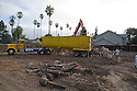 Demolition of a single family home. The debris is being loaded into a container truck and transported to the Zanker Road Landfill where wood, concrete, gypsum, and metal waste materials will be sorted for recycling. Cupertino, California, USA