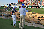 Rory McIlroy listens to the match referee's ruling after his 3rd shot ends up in the stream at the 18th green during  Day 3 at the Dubai World Championship Golf in Jumeirah, Earth Course, Golf Estates, Dubai  UAE, 21st November 2009 (Photo by Eoin Clarke/GOLFFILE)