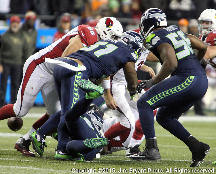 Arizona Cardinals quarterback Cason Palmer is stripped of the ball by Seattle Seahawks linebacker Bruce Irvin (51) at CenturyLink Field in Seattle, Washington on November 15, 2015. The Cardinals beat the Seahawks 39-32.   ©2015. Jim Bryant photo. All Rights Reserved.