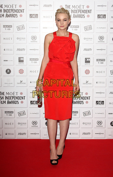 CAREY MULLIGAN .Attending the Moet British Independent Film Awards 2010 held at Old Billingsgate, London, England, UK, December 5th 2010..full length red sleeveless dress open toe shoes black clutch bag  .CAP/ROS.©Steve Ross/Capital Pictures.