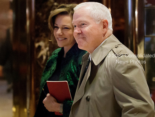 Former Defense United States Secretary of Defense Robert Gates (R) walks with K.T. McFarland (L), President-elect Donald Trump's Deputy National Security Advisor, through the lobby of Trump Tower in New York, New York, USA, 02 December 2016.<br /> Credit: Justin Lane / Pool via CNP