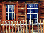 Bodie State Historic Park, CA<br /> Picket fence fronting weathered door and window at Bodie ghost town