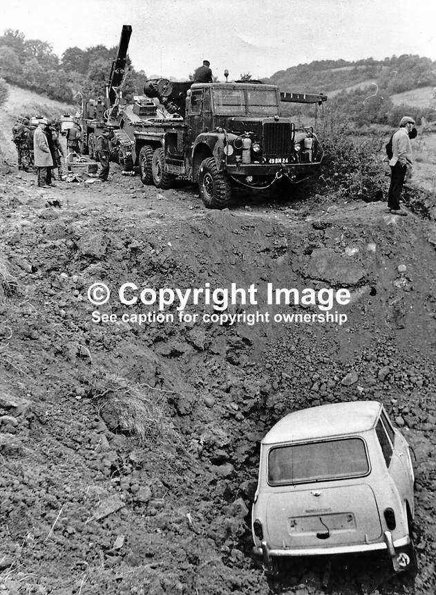 A woman driver in a Mini ended up in a massive crater caused by a Provisional IRA landmine explosion near Dungannon, Co Tyrone, N Ireland, on 10th September 1972. She was only slightly injured but two soldiers from the Argyll &amp; Sutherland Highlanders died in the blast. Five others, three seriously, were also injured in the incident. 19720911WP1<br />