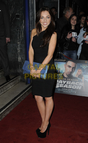 Louisa Lytton.The 'Payback Season' UK film premiere, Odeon Covent Garden cinema, Shaftesbury Avenue, London, England..March 6th, 2012.full length black one shoulder dress blue clutch bag .CAP/CAN.©Can Nguyen/Capital Pictures.
