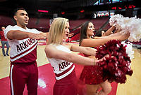 NWA Democrat-Gazette/CHARLIE KAIJO Arkansas Razorbacks cheerleaders call the hogs during an NCAA selection show, Sunday, March 11, 2018 at Bud Walton Arena in Fayetteville. The Razorbacks will play Butler in Detroit on Friday